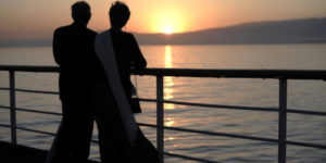 Couple on a cruise ship watching sunset